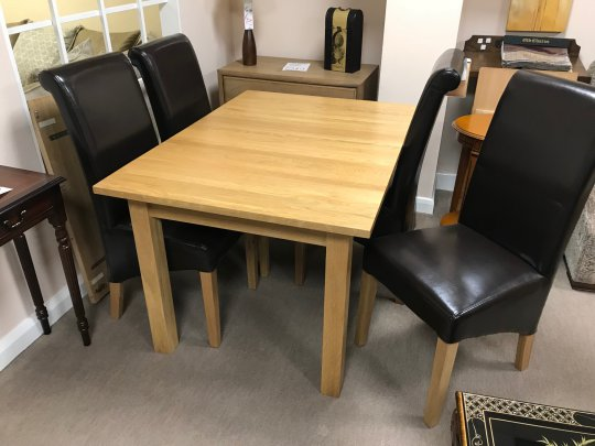 Nimbus Dining Table & 4 Padded Brown Chairs